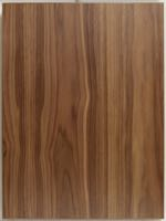 A Walnut slab style cabinet door made with flat cut Walnut veneer and a solid walnut edge band.