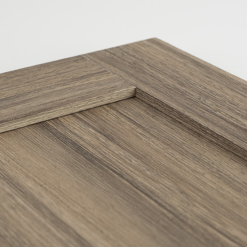 weathered chestnut laminate cabinet door inside corner detail